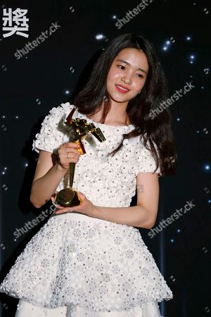 South Korea actress Kim Tae-Ri poses after winning the Best Newcomer Award of the Asian Film Awards in Hong Kong