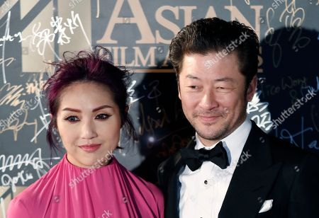Tadanobu Asano, Miriam Yeung Japanese actor Tadanobu Asano, right, and Hong Kong actress Miriam Yeung pose on the red carpet of the Asian Film Awards in Hong Kong