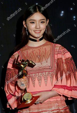 Chinese actress Yun Lin poses after winning the Rising Star of Asia Award of the Asian Film Awards in Hong Kong