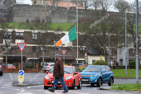 An Republic of Ireland flag flying at half mast in the centre of the Bogside area of Derry, Northern Ireland, 21 March 2017. Sinn Fein's Martin McGuinness, Northern Ireland's former deputy first minister, has died aged 66. It is understood he had been suffering from a rare heart condition. The former IRA leader turned peacemaker worked at the heart of the power-sharing government following the 1998 Good Friday Agreement. He became deputy first minister in 2007, standing alongside Democratic Unionist Party leaders Ian Paisley, Peter Robinson and Arlene Foster.