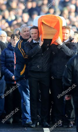 Fiachra McGuinness (2-R) and Emmet McGuinness (R) carry the coffin of their father Martin McGuinness through the streets the Bogside area of Derry, Northern Ireland, 21 March 2017. Sinn Fein's Martin McGuinness, Northern Ireland's former deputy first minister, has died aged 66. It is understood he had been suffering from a rare heart condition. The former IRA leader turned peacemaker worked at the heart of the power-sharing government following the 1998 Good Friday Agreement. He became deputy first minister in 2007, standing alongside Democratic Unionist Party leaders Ian Paisley, Peter Robinson and Arlene Foster.