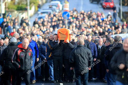 Fiachra McGuinness (C-L) and Emmet McGuinness (C-R) carry the coffin of their father Martin McGuinness through the streets the Bogside area of Derry, Northern Ireland, 21 March 2017. Sinn Fein's Martin McGuinness, Northern Ireland's former deputy first minister, has died aged 66. It is understood he had been suffering from a rare heart condition. The former IRA leader turned peacemaker worked at the heart of the power-sharing government following the 1998 Good Friday Agreement. He became deputy first minister in 2007, standing alongside Democratic Unionist Party leaders Ian Paisley, Peter Robinson and Arlene Foster.