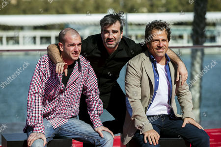 Uruguayan film director Daniel Hendler (C) and Uruguayan actors and castmembers Matias Singer (L) and Diego de Paula (R) pose for photographers after the presentation of the film 'El Candidato' at 20th Malaga Film Festival, southern Spain, 21 March 2017.