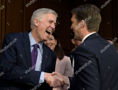 Neil Gorsuch, Ben Sasse Supreme Court Justice nominee Neil Gorsuch, left, shares a laugh with Senate Judiciary Committee member Senator Ben Sasse, R-Neb.as he arrives on Capitol Hill in Washington, for his confirmation hearing before the Senate Judiciary Committee. Former New Hampshire Senator Kelly Ayotte is at center