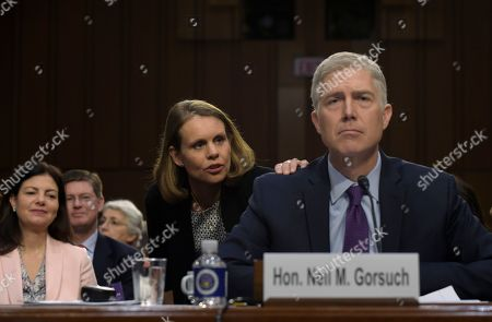 Neil Gorsuch, Marie Louise Gorsuch Marie Louise Gorsuch, center, wife of Supreme Court Justice nominee Neil Gorsuch, talks to her husband as testifies on Capitol Hill in Washington, during his confirmation hearing before the Senate Judiciary Committee. Former New Hampshire Senator Kelly Ayotte is at left