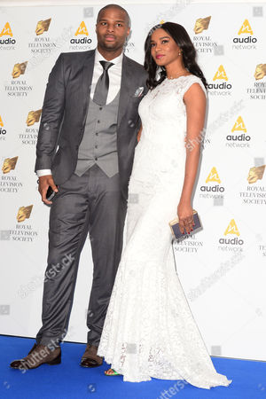 Stock Image of Osi Umenyiora with his wife Leila Lopes