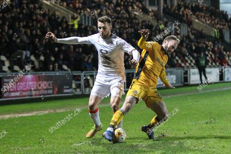 Stephen O'Donnell of Luton Town is tackled by Sean Rigg of Newport County during the EFL Sky Bet League 2 match between Newport County and Luton Town at Rodney Parade, Newport