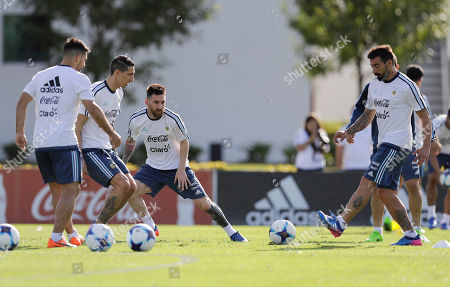 Argentina's from left to right, Sergio Aguero, Angel Di Maria, Lionel Messi and Ezequiel Lavezzi, attend a training session of the national soccer team before a 2018 Russia World Cup qualifying soccer match against Chile in Buenos Aires, Argentina