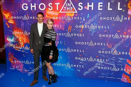 Actress Scarlett Johansson poses with director Rupert Sanders during a photo call for the french premiere of 'Ghost in the Shell' in Paris