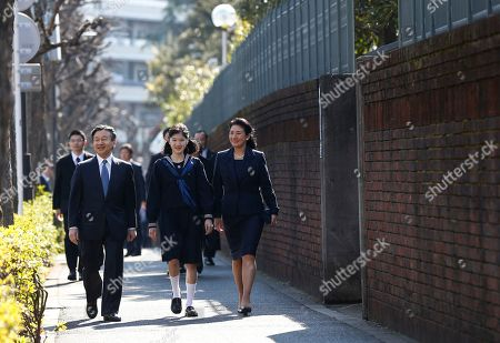 Japan's Princess Aiko, center, accompanied by her parents Crown Prince Naruhito and Crown Princess Masako, arrives at her graduation ceremony at the Gakushuin Girls' Junior High School in Tokyo