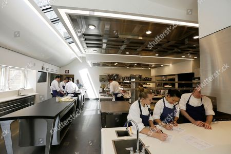 Part of the team at the French Laundry restaurant make preparations in the kitchen for dinner service in Yountville, Calif. Celebrated chef Thomas Keller has just opened a state-of-the art new kitchen at his famed French Laundry after spending $10 million on an extensive renovation