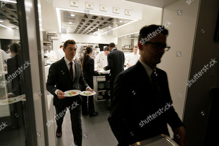 Servers leave the kitchen and make their way to the dining room at the French Laundry restaurant in Yountville, Calif. Celebrated chef Thomas Keller has just opened a state-of-the art new kitchen at his famed French Laundry after spending $10 million on an extensive renovation