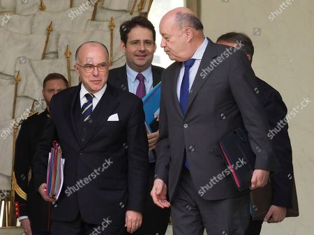 From left, French Prime Minister Bernard Cazeneuve, New French Interior Minister Matthias Fekl and French minister for Town and Country planning, rural affairs and local authorities Jean-Michel Baylet, leave the weekly cabinet meeting, at the Elysee Palace, in Paris