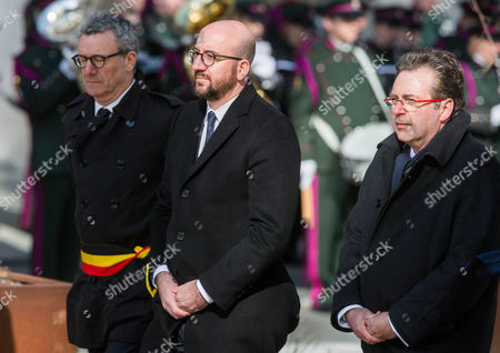 (L-R) Brussels City Mayor Yvan Mayeur, Belgian Prime Minister Charles Michel and Rudi Vervoort, Minister-President of the Brussels-Capital Region during a commemorative event on the first anniversary of the Brussels terrorist attacks, in Brussels, Belgium, 22 March 2017. On the same day in 2016 a total of 31 people were killed and hundreds others injured in terrorist attacks on the Brussel Airport and on the Maalbeek Metro station for which the so-called 'Islamic State' (IS) later had claimed responsibility.