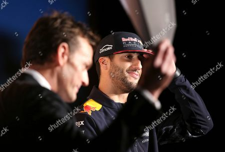 Red Bull driver Daniel Ricciardo, right, of Australia is interviewed by former Australian cricket player Adam Gilchrist during a promotional event in Melbourne, . Ricciardo is back in Melbourne for Sunday's season-opening Australian Grand Prix, where F1 rule changes requiring wider tires, greater aerodynamics, bigger fuel loads and increased downforce are expected to make the heavier cars significantly faster than previous years