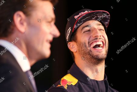 Red Bull driver Daniel Ricciardo, right, of Australia, laughs as he is interviewed by former Australian cricket player Adam Gilchrist during a promotional event in Melbourne, . Ricciardo is back in Melbourne for Sunday's season-opening Australian Grand Prix, where F1 rule changes requiring wider tires, greater aerodynamics, bigger fuel loads and increased downforce are expected to make the heavier cars significantly faster than previous years