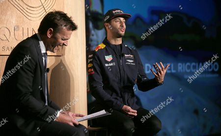 Red Bull driver Daniel Ricciardo, right, of Australia, is interviewed by former Australian cricket player Adam Gilchrist during a promotional event in Melbourne, . Ricciardo is back in Melbourne for Sunday's season-opening Australian Grand Prix, where F1 rule changes requiring wider tires, greater aerodynamics, bigger fuel loads and increased downforce are expected to make the heavier cars significantly faster than previous years