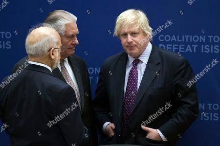 Secretary of State Rex Tillerson, center, talks with British Foreign Minister Boris Johnson, right and Iraqi Foreign Minister Ibrahim Jafari, left, during the Meeting of the Ministers of the Global Coalition on the Defeat of ISIS, at the State Department in Washington. Top officials from the 68-nation coalition fighting the Islamic State group are looking to increase pressure on the group as U.S.-backed forces move closer to retaking Mosul