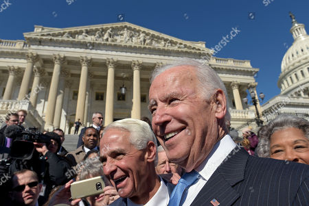 Charlie Crist, Joe Biden Former Vice President Joe Biden, right, and Rep. Charlie Crist, D-Fla., left, greet the crowd on Capitol Hill in Washington, . Biden is on Capitol Hill to defend former President Barack Obama's Affordable Care Act