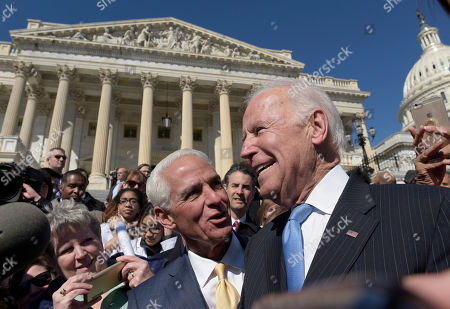 Charlie Crist, Joe Biden Former Vice President Joe Biden, right, and Rep. Charlie Crist, D-Fla., second from right, greet the people in the crowd on Capitol Hill in Washington, following an event marking seven years since former President Barack Obama signed the Affordable Care Act into law