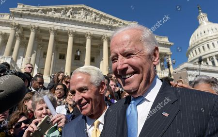 Stock Image of Charlie Crist, Joe Biden Former Vice President Joe Biden, right, and Rep. Charlie Crist, D-Fla., right, greet the crowd on Capitol Hill in Washington, following an event marking seven years since former President Barack Obama signed the Affordable Care Act into law