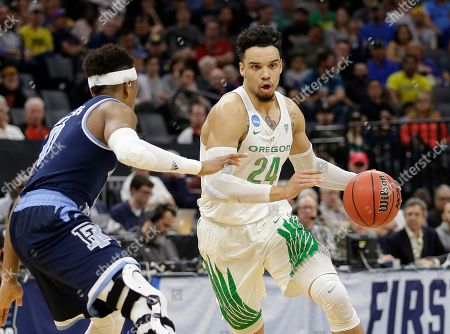 E. C. Matthews, Dillon Brooks Oregon forward Dillon Brooks, right, drives against Rhode Island guard E.C. Matthews during the first half of a second-round game of the men's NCAA college basketball tournament in Sacramento, Calif