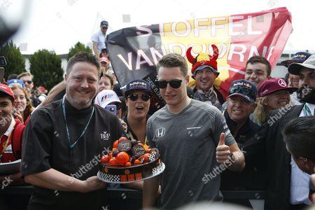 Birthday boy Stoffel Vandoorne of Belgium driving for McLaren Honda is presented with a birthday cake on Sunday at the Rolex Australian F1 Grand Prix.