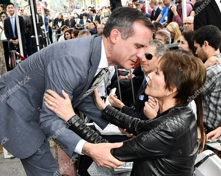 Stock Picture of Mayor Eric Garcetti and Cheryl Saban