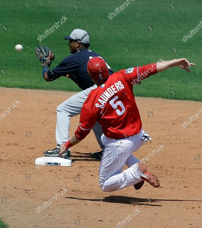 Starlin Castro, Michael Saunders New York Yankees second baseman Starlin Castro, left, forces Philadelphia Phillies' Michael Saunders (5) out at second base but is unable to complete a double play in the fourth inning of a spring training baseball game, in Clearwater, Fla