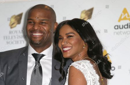 Stock Photo of Osi Umenyiora and Leila Lopes