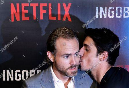 """Erik Hayser, Alberto Guerra Cuban actor Alberto Guerra plants a kiss on Mexican actor Erik Hayser during a media call to promote the Netflix series, """"Ingobernable"""" in Mexico City"""