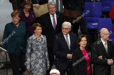 The Presidents of the Bundestag, Norbert Lammert (R) and the Bundesrat, Malu Dreyer (L) followed by new German President Frank Walter Steinmeier (C) with his wife Elke Buedenbender (2L), Chancellor Angela Merkel (far L), former President Joachim Gauck and his partner Daniela Schadt (last row) arrive for the swearing in ceremony in the Bundestag in Berlin, Germany, 22 March 2017. Steinmeier becomes the twelfth President of the Federal Republic of Germany.