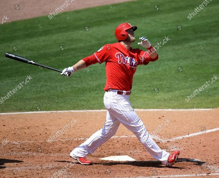Philadelphia Phillies' Michael Saunders bats against the New York Yankees in a spring training baseball game, in Clearwater, Fla