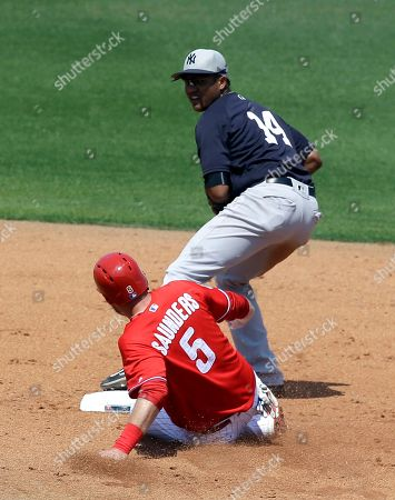 Starlin Castro, Michael Saunders New York Yankees second baseman Starlin Castro, right, forces Philadelphia Phillies' Michael Saunders (5) out at second base but is unable to complete a double play in the fourth inning of a spring training baseball game, in Clearwater, Fla