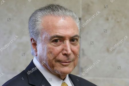 Brazil's President Michel Temer arrives to attend a swearing-in ceremony of the newly-confirmed Justice Minister Alexandre de Moraes, in Brasilia, Brazil