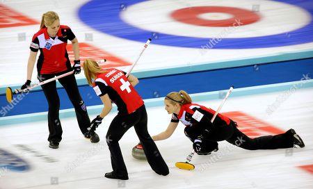 Marisa Winkelhausen, Nadine Lehmann, Nicole Schwagli Switzerland's Marisa Winkelhausen releases the stone as her teammates Nadine Lehmann, left, and Nicole Schwagli, center, watch during their match against the United States in the CPT World Women's Curling Championship in Beijing