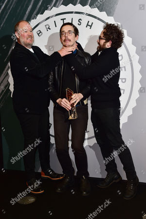 Jim Hosking, Ant Timpson and Toby Harvard collect the Discovery Award at The British Independent Film Awards (BIFA) at Old Billingsgate, London on the 4th December 2016.
