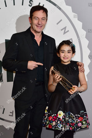 Avin Manshadi with her award for Best Supporting Actress presented by Jason Isaacs at The British Independent Film Awards (BIFA) at Old Billingsgate, London on the 4th December 2016.