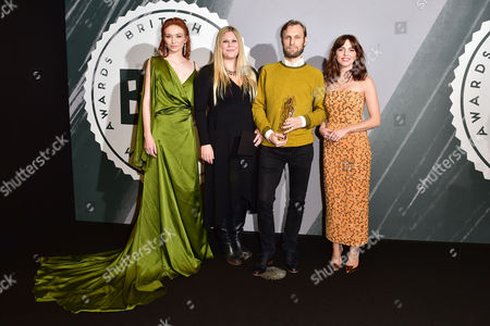 Stock Image of Rene Pannevis and Jennifer Eriksson with their award for Best Short presented by Eleanor Tomlinson and Ophelia Lovibond at The British Independent Film Awards (BIFA) at Old Billingsgate, London on the 4th December 2016.