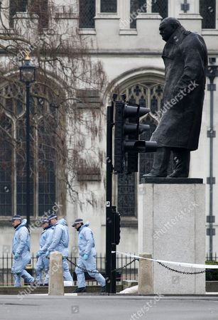 Police officers search Parliament Square behind the statue of, British war time leader, Winston Chruchill, in Parliament Square outside the Houses of Parliament in London, Britain 23 March 2017. Scotland Yard said on 23 March 2017 that police have made seven arrests in raids carried out over night in Birmingham London and elsewhere in the country after the terror attack in the Westminister Palace grounds and on Westminster Bridge on 22 March 2017 leaving four people dead, including the attacker, and 29 people injured.