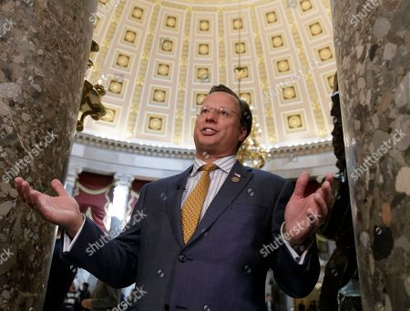 """Nancy Pelosi, Thomas Vos Rep. Dave Brat, R-Va., a member of the conservative Freedom Caucus, explains his position to a TV interviewer before his group met with President Donald Trump as the GOP's long-promised legislation to repeal and replace """"Obamacare"""" moves to a showdown vote, on Capitol Hill in Washington"""
