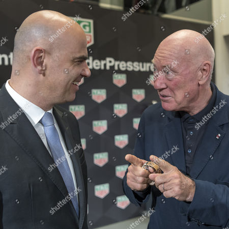 Swiss federal councillor Alain Berset (L) talks to Jean-Claude Biver, CEO of TAG Heuer, at the TAG Heuer booth, during the official opening day of the world watch and jewellery show Baselworld in Basel, Switzerland, 23 March 2017.