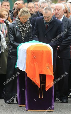 Martin McGuinness' coffin is draped with the Irish flag outside St. Columba's Church in Londonderry, Northern Ireland, 23 March 2017, ahead of the funeral of the late Sinn Fein leader. Sinn Fein's Martin McGuinness, Northern Ireland's former deputy first minister, died aged 66 on 21 March 2017. It is understood he had been suffering from a rare heart condition. The former IRA leader turned peacemaker worked at the heart of the power-sharing government following the 1998 Good Friday Agreement. He became deputy first minister in 2007, standing alongside Democratic Unionist Party leaders Ian Paisley, Peter Robinson and Arlene Foster.