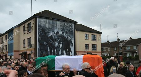 The coffin of Martin McGuinness is carried pass the 'Bloody Sunday' mural in Londonderry, Northern Ireland, 23 March 2017, during the funeral of the late Sinn Fein leader. Sinn Fein's Martin McGuinness, Northern Ireland's former deputy first minister, died aged 66 on 21 March 2017. It is understood he had been suffering from a rare heart condition. The former IRA leader turned peacemaker worked at the heart of the power-sharing government following the 1998 Good Friday Agreement. He became deputy first minister in 2007, standing alongside Democratic Unionist Party leaders Ian Paisley, Peter Robinson and Arlene Foster.