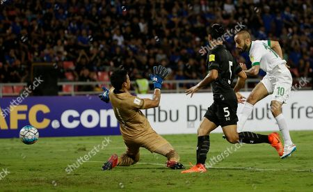 Mohammad Al-Sahlawi of Saudi Arabia, right, shoots to score during their World Cup qualifier soccer match in the first half at Rajamangala national stadium in Bangkok, Thailand