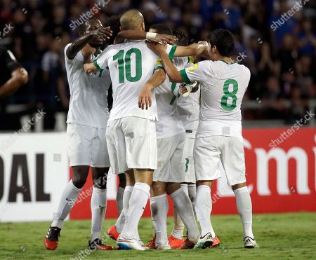 Mohammad Al-Sahlawi of Saudi Arabia, center no. 10, is congratulated by his teammates after scoring against Thailand during their World Cup qualifier soccer match in the first half at Rajamangala national stadium in Bangkok, Thailand