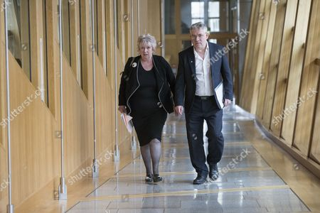 Stock Picture of Scottish Parliament First Minister's Questions - Christine Grahame, Deputy Presiding Office of The Scottish Parliament, and Kenneth Gibson make their way to the Debating Chamber