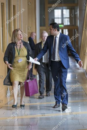 Scottish Parliament First Minister's Questions - Linda Fabiani, Deputy Presiding Office of The Scottish Parliament, Anas Sarwar and (behind) John Mason make their way to the Debating Chamber