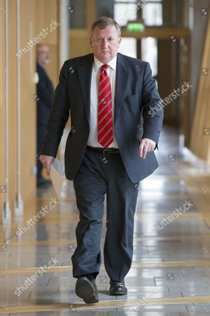 Scottish Parliament First Minister's Questions - Alex Rowley, Deputy Leader of the Scottish Labour Party, makes his way to the Debating Chamber