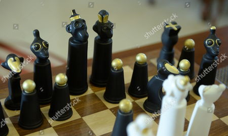 Stock Photo of A porcelain Monkey Chess set is on display at the Cmielow China Factory, in Cmielow, south Poland, 23 March 2017. Designed by Adam Spala in 2017, the set consists of 32 porcelain beads: 16 white and 16 black. Each piece was handmade from porcelain and then decorated with 24-carat liquid gold. In addition, each chess piece has an individual product number.